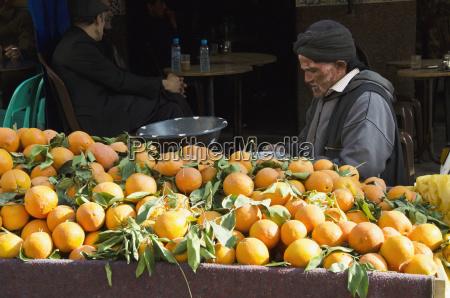 orange vendor at market old medina