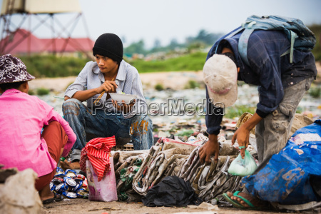 cambodia men pause for meal in