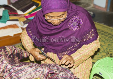 woman mending a garment at a