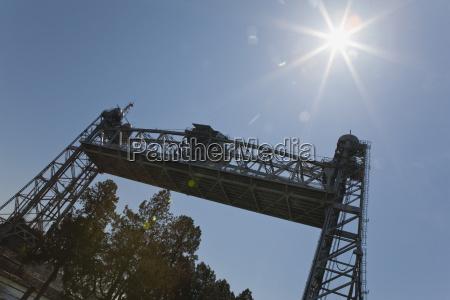 suspension bridge raised with sun burst