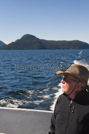 a traveler enjoys a ferry ride