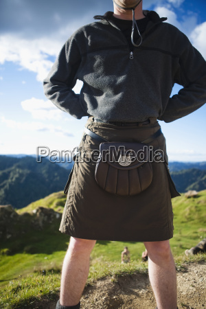 a man wearing a skirt and