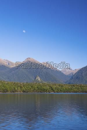 mountains and shoreline of lake manapouri