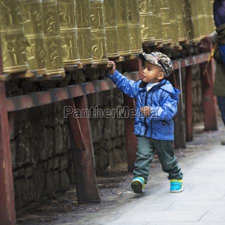 china xizang tibet lhasa boys walking