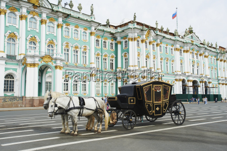 horse drawn carriage in front of
