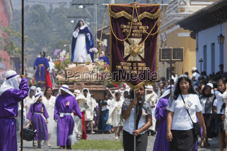 women dressed in mourning carry the