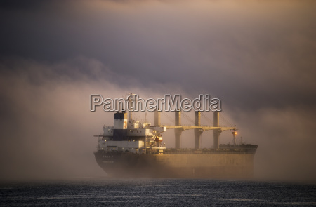 a ship anchors in the fog