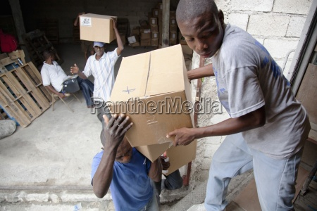 men unload boxes from a truck