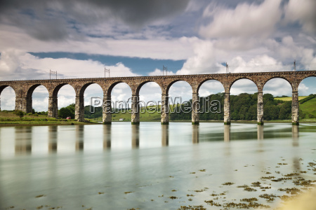 a bridge with arches reflected in