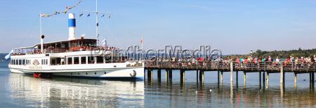 a ferry arrives at a pier