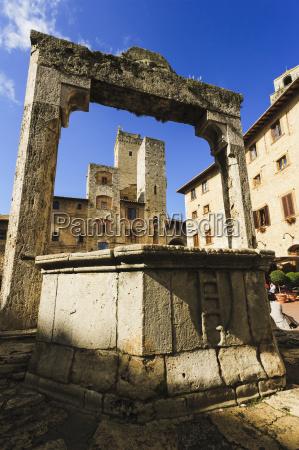 a historic stone archway san gimignano