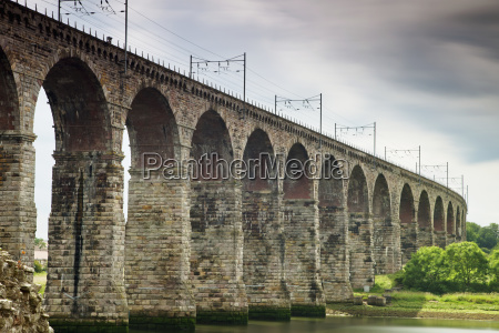 a bridge with arches and power