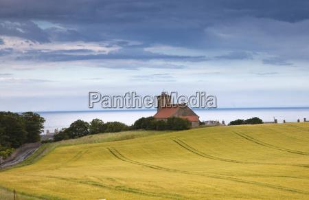 a building and farmland st abbs