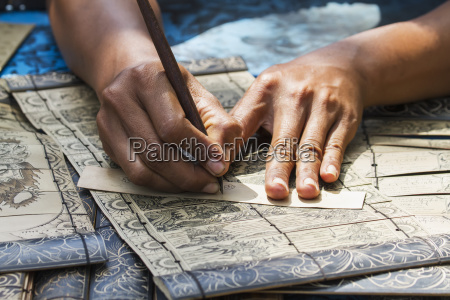 man carving the ancient tales in