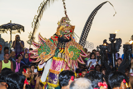 garuda surrounded by men sitting in