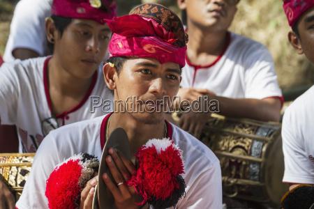 man in a gamelan ensemble preforming