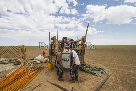men loading a safe to a