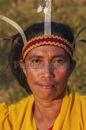 manggarai woman wearing a traditional headdress
