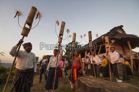 manggarai men performing a traditional dance
