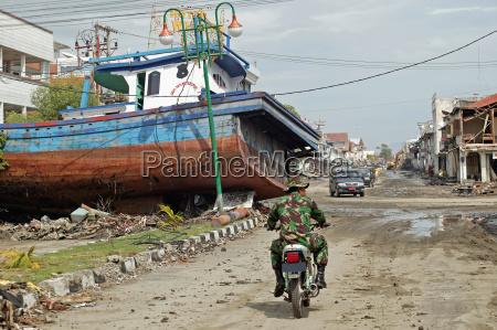 a fishing trawler washed up onto