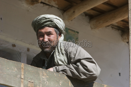 afghan man on the balcony of