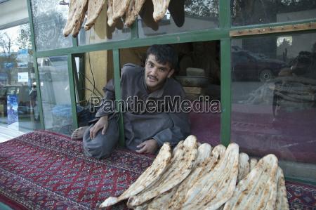 afghan man selling nan unleavened bread