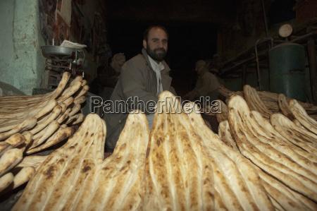 afghan man and freshly baked nan