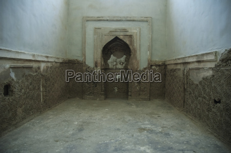 deteriorating stucco decoration from mihrab of