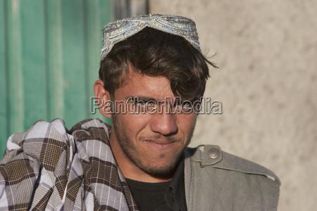 young afghan man in jalrez vardak