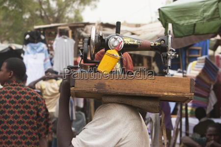 tailor carrying sewing machine in bamako