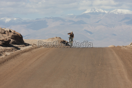 man on a mountain bike travelling