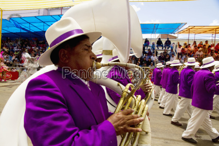 tuba players in a marching band