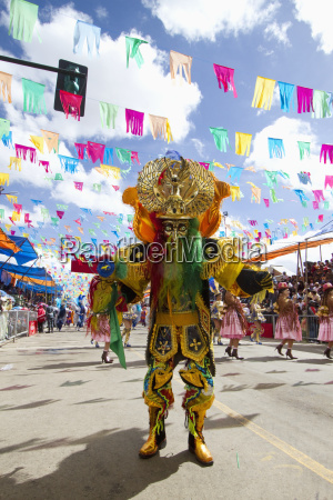 morenada dancer wearing an elaborate mask