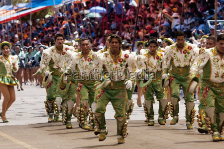 caporales dancers in the procession of