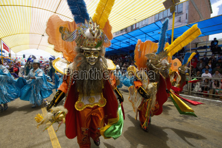 morenada dancers wearing elaborate masks and