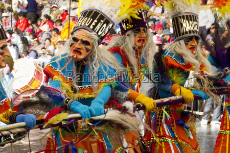 tobas dancers wearing elaborate masks feather