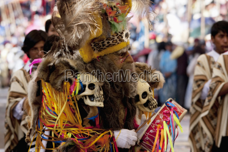 tobas dancer wearing an elaborate mask