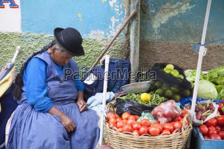 aymara woman sleeping at her produce