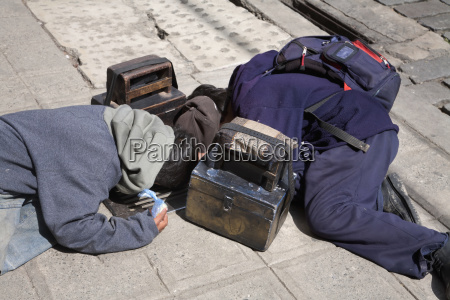 shoeshine boys looking for a coin