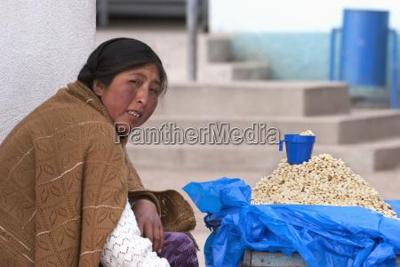 aymara woman selling boiled lima beans