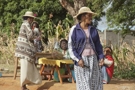 women selling food along the road