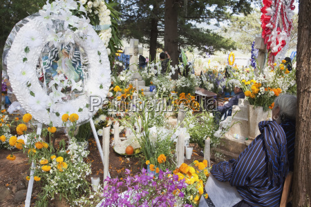 old woman by a grave during