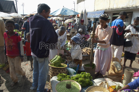 woman pounding parsley at the weekly