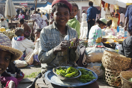 boy selling peppers at the weekly