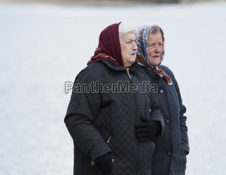 old women walking by the shores