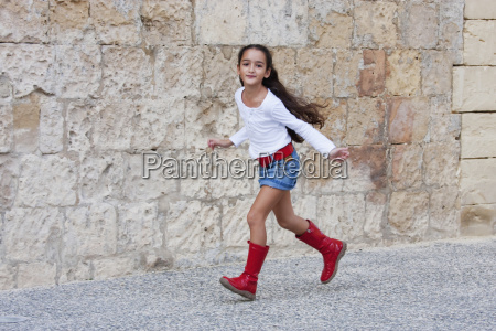 girl wearing red boots valletta malta