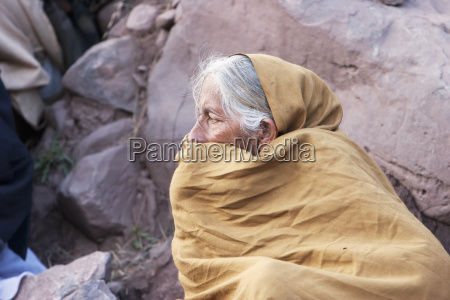 old woman waiting for aid and
