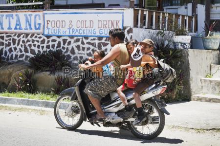 children on a motorcycle simanindo samosir