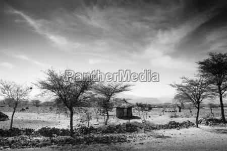 stone hut set in grassland plains