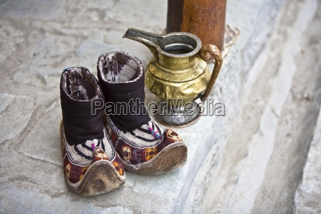 moccasins and water jug on front